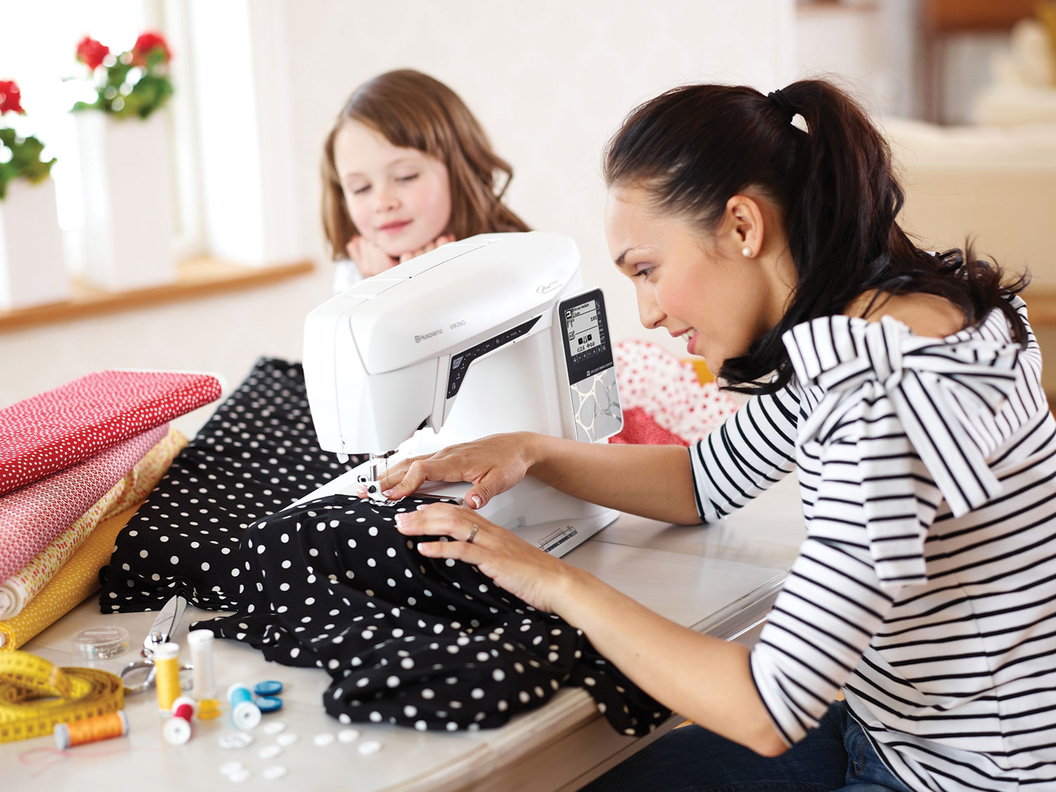 Woman Sewing with the Opal 690Q